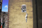 Banksy Bristol Hanging out window